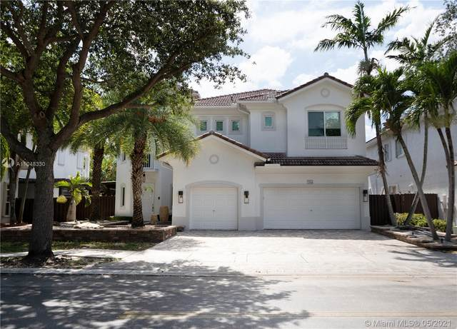 7044 NW 113th Pl, Doral, FL 33178 (MLS #A11048330) :: The Riley Smith Group