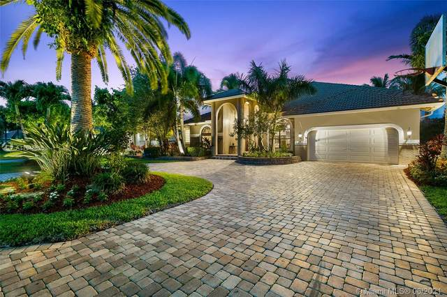 6020 NW 60th Ave, Parkland, FL 33067 (MLS #A11048636) :: United Realty Group
