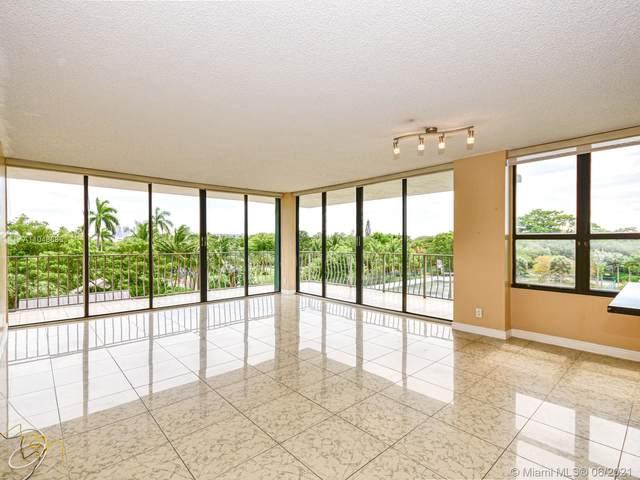 780 NE 69th St #409, Miami, FL 33138 (MLS #A11048685) :: Berkshire Hathaway HomeServices EWM Realty