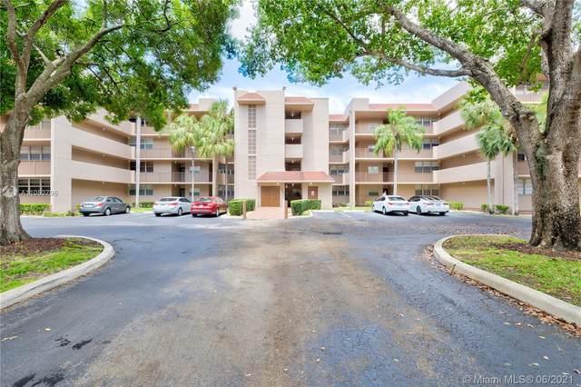 1831 Sabal Palm Dr #205, Davie, FL 33324 (MLS #A11052796) :: Castelli Real Estate Services