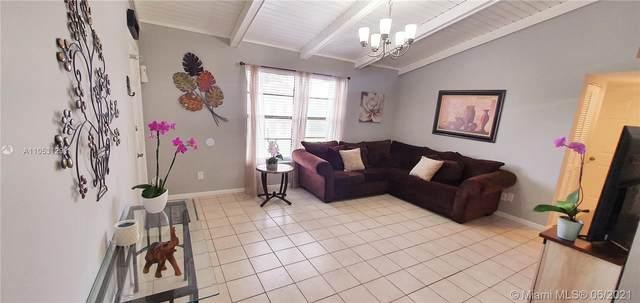 5894 Longbow Ln #10, West Palm Beach, FL 33415 (MLS #A11053129) :: Berkshire Hathaway HomeServices EWM Realty
