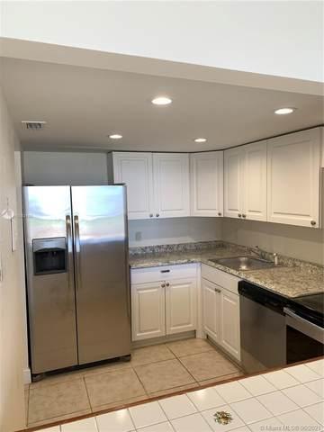 13499 Biscayne Blvd #402, North Miami, FL 33181 (#A11053148) :: Posh Properties