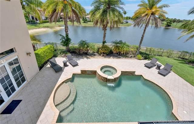 12115 NW 71 St, Parkland, FL 33076 (MLS #A11053500) :: Berkshire Hathaway HomeServices EWM Realty