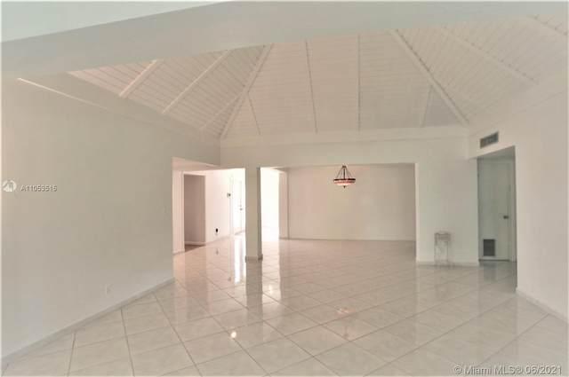 6002 Dogwood Cir, Tamarac, FL 33319 (MLS #A11053515) :: Berkshire Hathaway HomeServices EWM Realty