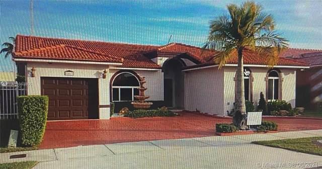 8863 NW 142nd Ln, Miami Lakes, FL 33018 (MLS #A11053805) :: Berkshire Hathaway HomeServices EWM Realty