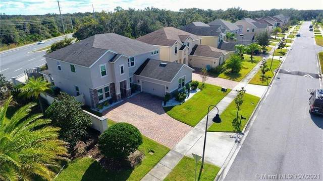 14763 Golden Sunburst Ave, Orlando, FL 32827 (MLS #A11057458) :: The Teri Arbogast Team at Keller Williams Partners SW