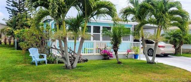 906 Pecan, Barefoot Bay, FL 32976 (MLS #A11057682) :: The Teri Arbogast Team at Keller Williams Partners SW