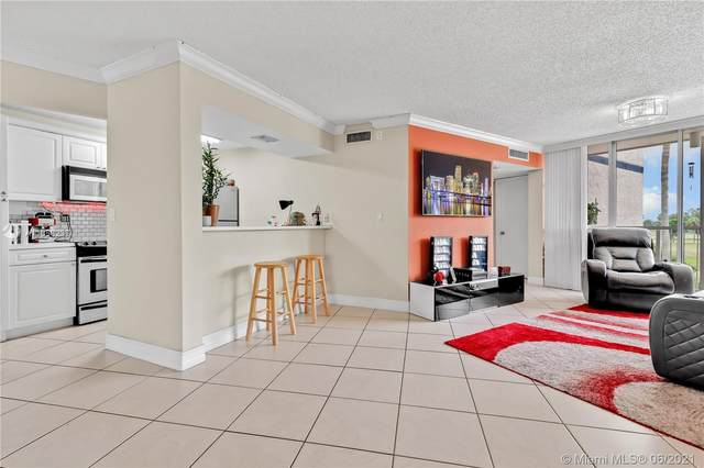 7075 NW 186th St C304, Hialeah, FL 33015 (MLS #A11058237) :: The Howland Group