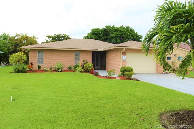 7013 NW 101st Ave, Tamarac, FL 33321 (MLS #A11059350) :: The Riley Smith Group