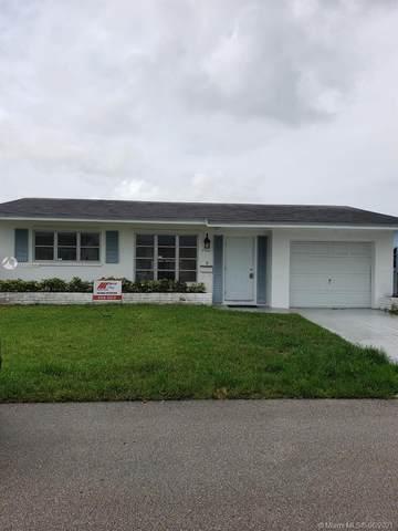 4920 NW 54th Ct, Tamarac, FL 33319 (MLS #A11060008) :: Berkshire Hathaway HomeServices EWM Realty