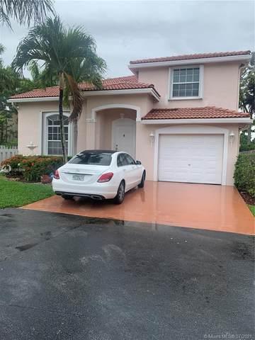 4569 NW 60th Ct, Coconut Creek, FL 33073 (MLS #A11064999) :: Re/Max PowerPro Realty