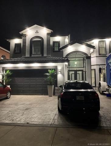 10911 SW 242nd St, Homestead, FL 33032 (MLS #A11072090) :: Prestige Realty Group