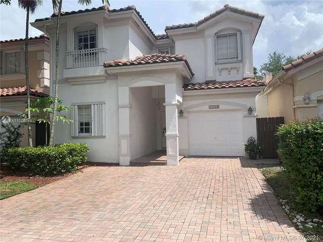 10928 NW 69th St, Doral, FL 33178 (MLS #A11074686) :: Douglas Elliman