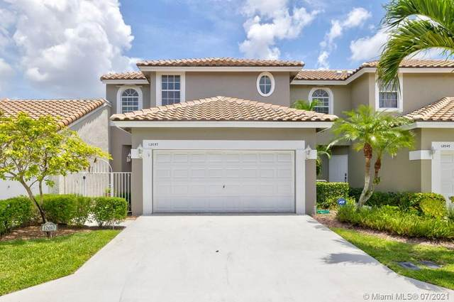 12057 NW 56th Street #12057, Coral Springs, FL 33076 (MLS #A11075829) :: Vigny Arduz | RE/MAX Advance Realty