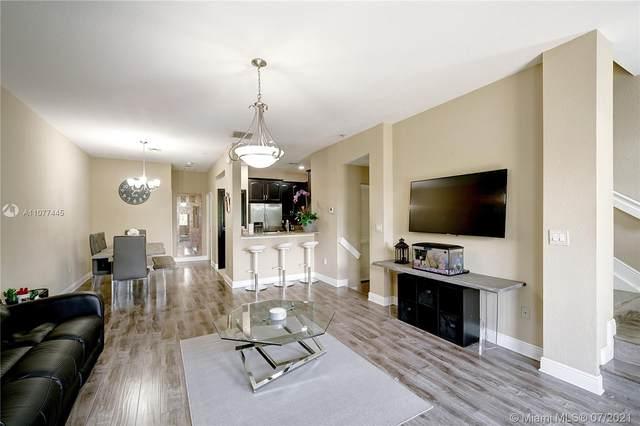 11898 SW 25th Ct #103, Miramar, FL 33025 (MLS #A11077445) :: Berkshire Hathaway HomeServices EWM Realty
