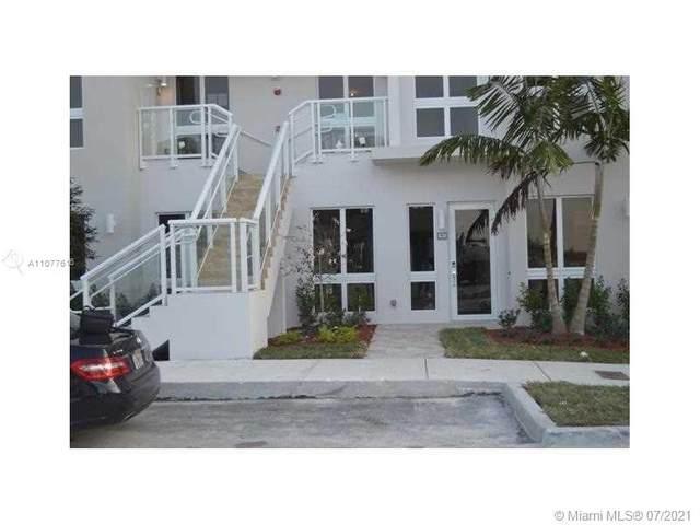 10260 NW 63rd Ter #103, Doral, FL 33178 (MLS #A11077616) :: Berkshire Hathaway HomeServices EWM Realty
