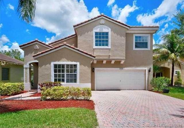 12629 NW 6th Ct, Coral Springs, FL 33071 (MLS #A11077670) :: Berkshire Hathaway HomeServices EWM Realty