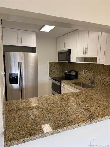6090 W 18th Ave #332, Hialeah, FL 33012 (MLS #A11077779) :: GK Realty Group LLC