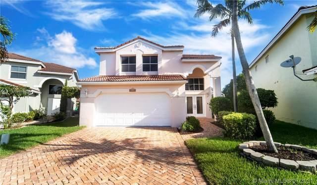 11047 NW 34th Mnr, Coral Springs, FL 33065 (MLS #A11078108) :: Equity Advisor Team