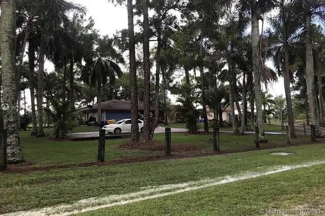 12988 N 61st St N, West Palm Beach, FL 33412 (MLS #A11078303) :: Vigny Arduz | RE/MAX Advance Realty
