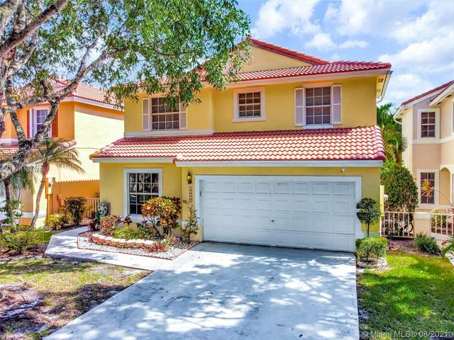 10918 NW 46th Dr, Coral Springs, FL 33076 (MLS #A11085286) :: Berkshire Hathaway HomeServices EWM Realty