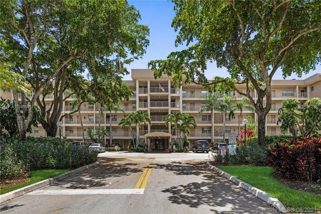 4030 W Palm Aire Dr #408, Pompano Beach, FL 33069 (MLS #A11089585) :: GK Realty Group LLC