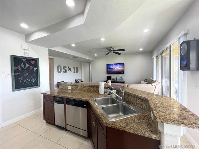 12782 NW 83rd Ct 36-C, Parkland, FL 33076 (MLS #A11095137) :: Berkshire Hathaway HomeServices EWM Realty