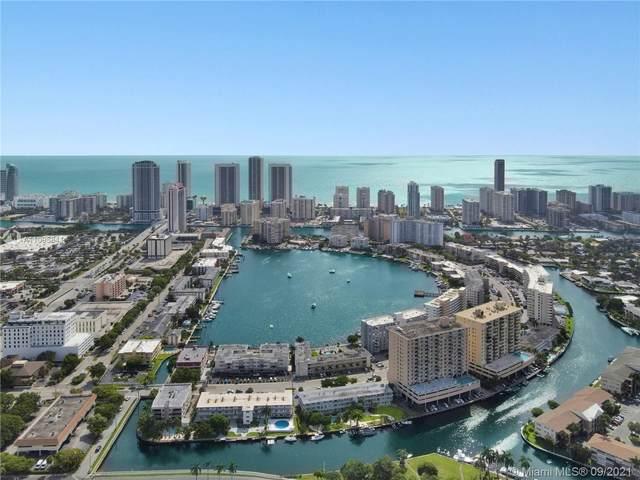 455 Golden Isles Dr #105, Hallandale Beach, FL 33009 (MLS #A11095841) :: GK Realty Group LLC