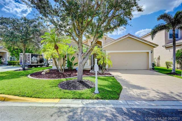 5230 NW 112th Way, Coral Springs, FL 33076 (MLS #A11101230) :: Berkshire Hathaway HomeServices EWM Realty