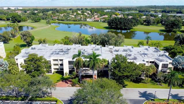 16251 NW Golf Club Rd #201, Weston, FL 33326 (MLS #A11104533) :: The Teri Arbogast Team at Keller Williams Partners SW