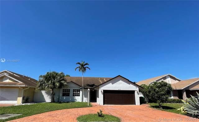 18940 NW 78th Ave, Hialeah, FL 33015 (MLS #A11105077) :: Rivas Vargas Group