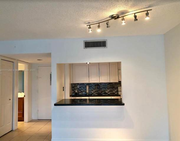 120 Lakeview Dr #214, Weston, FL 33326 (MLS #A11111250) :: The Teri Arbogast Team at Keller Williams Partners SW