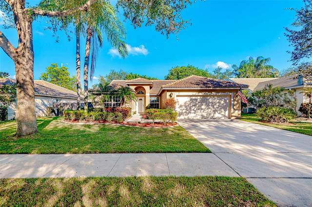 7580 NW 47th Ave, Coconut Creek, FL 33073 (MLS #A11112158) :: Re/Max PowerPro Realty