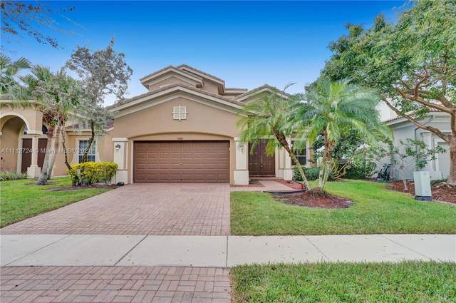 12480 NW 78th Mnr, Parkland, FL 33076 (MLS #A11112724) :: Berkshire Hathaway HomeServices EWM Realty