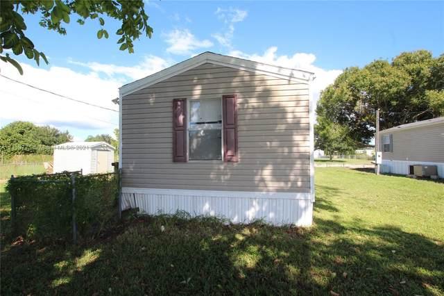 1367 Lake Drive W, Bulkhead Ridge, FL 34974 (MLS #A11113771) :: Douglas Elliman