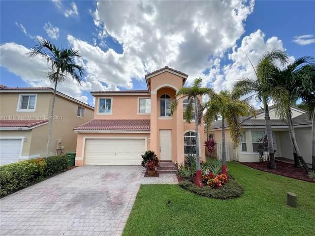 7682 NW 19th St, Pembroke Pines, FL 33024 (MLS #A11115031) :: Berkshire Hathaway HomeServices EWM Realty
