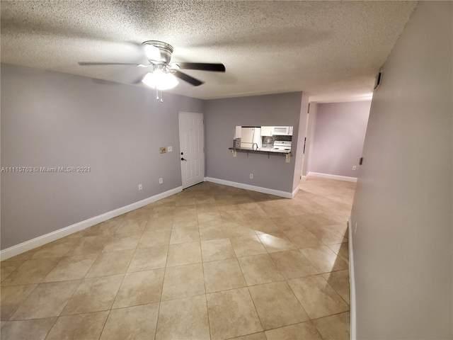1701 Village Blvd #106, West Palm Beach, FL 33409 (MLS #A11115763) :: The Rose Harris Group