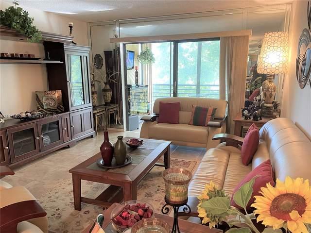 6090 N Sabal Palm Blvd #310, Tamarac, FL 33319 (MLS #A11116853) :: Patty Accorto Team