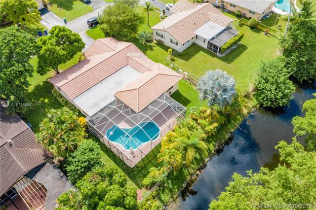 4160 NW 103rd Dr, Coral Springs, FL 33065 (MLS #A10738686) :: Castelli Real Estate Services