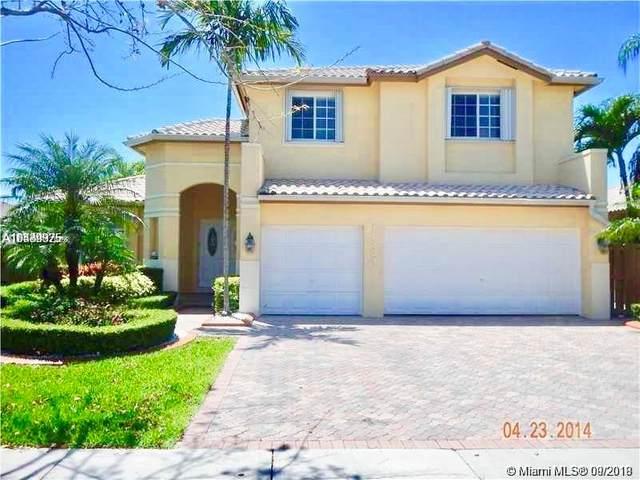 11324 NW 66th St, Doral, FL 33178 (MLS #A10742663) :: Berkshire Hathaway HomeServices EWM Realty