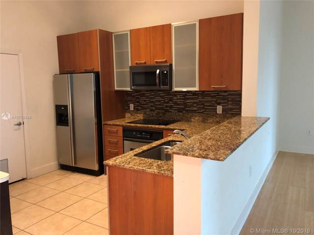 9055 SW 73rd Ct #408, Pinecrest, FL 33156 (MLS #A10753388) :: Grove Properties