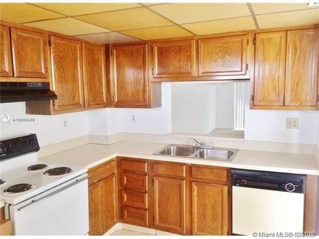 8735 Ramblewood Dr #412, Coral Springs, FL 33071 (MLS #A10805876) :: Berkshire Hathaway HomeServices EWM Realty