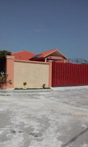 HOUSE IN CALLE 4 Esquina 7 Punta Cana, Brisos De Punta Cana, FL  (MLS #A10815442) :: Equity Advisor Team