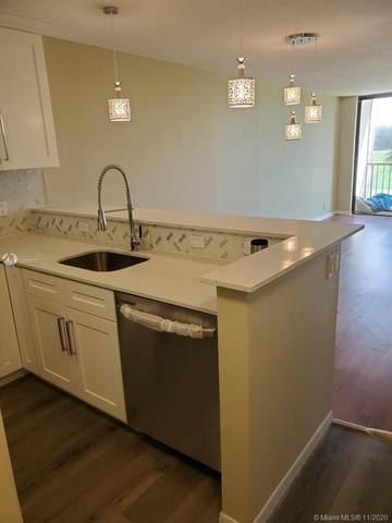 4090 Tivoli Ct #205, Lake Worth, FL 33467 (MLS #A10866272) :: Berkshire Hathaway HomeServices EWM Realty