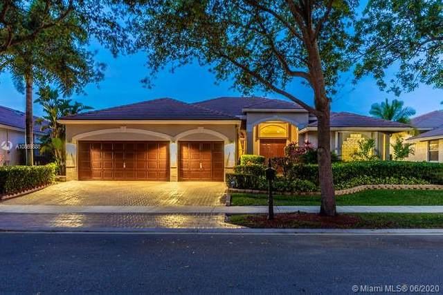 3811 Oak Ridge Cir, Weston, FL 33331 (MLS #A10869888) :: Berkshire Hathaway HomeServices EWM Realty