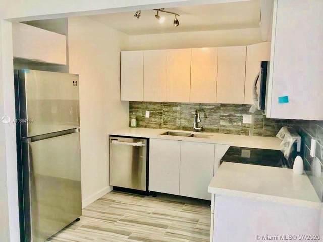 2029 NW 46th Ave E409, Lauderhill, FL 33313 (MLS #A10884939) :: Grove Properties