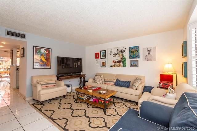 10091 SW 77th Ct #10091, Miami, FL 33156 (MLS #A10887138) :: Grove Properties
