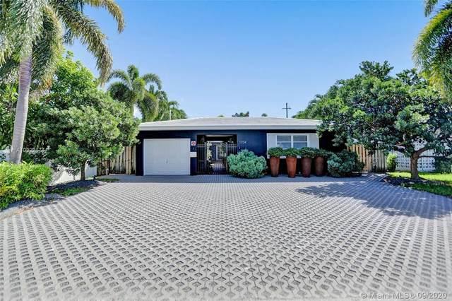 1734 NE 20th Ave, Fort Lauderdale, FL 33305 (MLS #A10922174) :: Berkshire Hathaway HomeServices EWM Realty