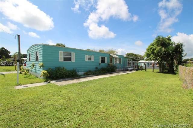 1208 6th Street, Bulkhead Ridge, FL 34974 (MLS #A10930297) :: Prestige Realty Group