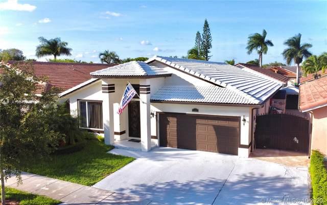 8937 NW 146th Ter, Miami Lakes, FL 33018 (MLS #A10949570) :: Berkshire Hathaway HomeServices EWM Realty
